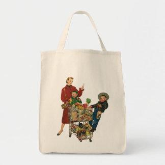 Familia, mamá y niños retros, compras del carro bolsas