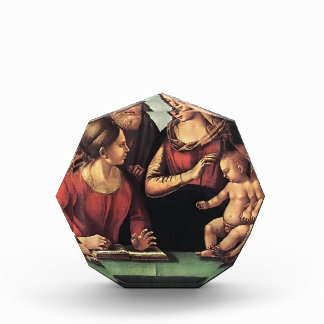 Familia santa de Luca Signorelli- con St. Catherin