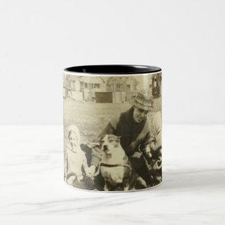 Family and dog on grass mug