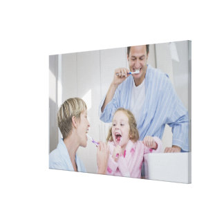 Family brushing teeth together stretched canvas prints