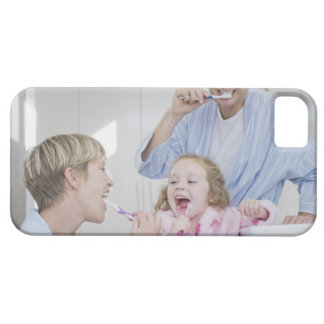 Family brushing teeth together iPhone 5 covers