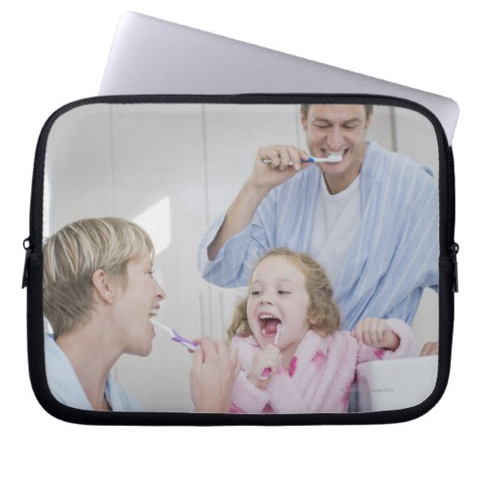 Family brushing teeth together computer sleeve