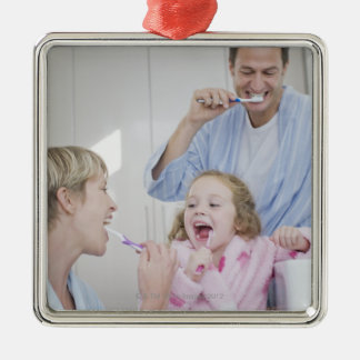 Family brushing teeth together metal ornament