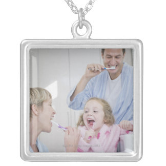 Family brushing teeth together silver plated necklace