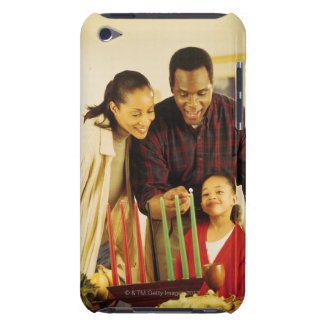 Family lighting the Kinara for Kwanzaa iPod Case-Mate Case