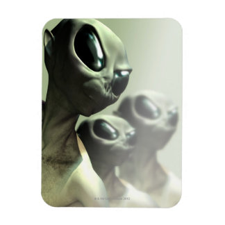 Family of aliens huddled together. magnet