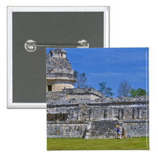 Family of tourists walk past ancient Mayan Pinback Button