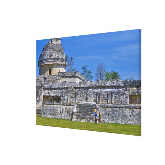 Family of tourists walk past ancient Mayan Canvas Print