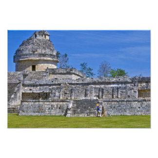 Family of tourists walk past ancient Mayan Art Photo