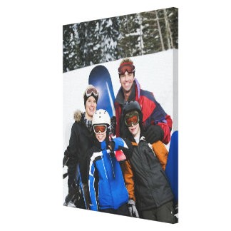 Family portrait with snowboards canvas print