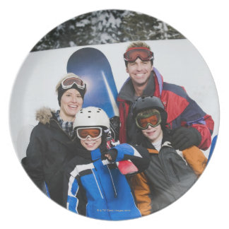 Family portrait with snowboards plate