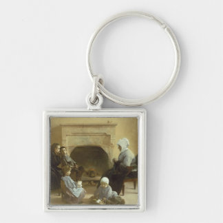 Family seated around a hearth keychain