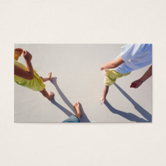Family walking at beach business card