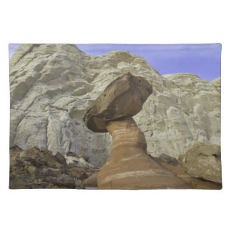 Fanciful toadstool shape of eroded red and white cloth place mat