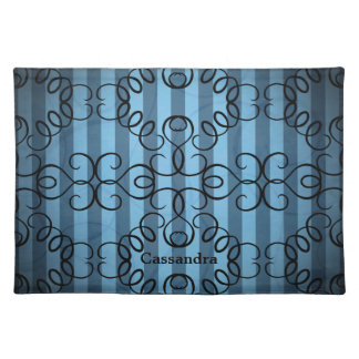 Fancy black swirl design on blue stripes placemat
