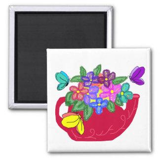 Fancy flowers in tea pot with butterflies magnet