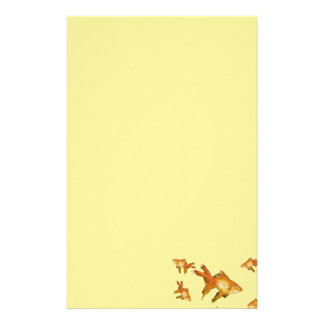fancy gold goldfish swimming in aquarium stationery