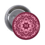 Fancy pink victorian motif on burgundy monogram pinback buttons