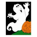 Fantasma y calabaza del dibujo animado postal