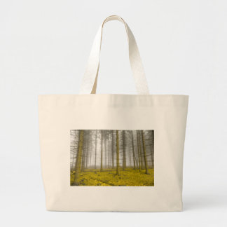fantasy forest with fog and yellow foliage large tote bag