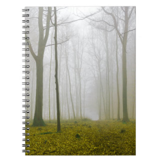 Fantasy forest with fog and yellow foliage notebook
