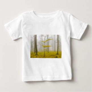 Fantasy forest with fog and yellow leaves baby T-Shirt