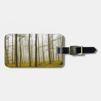 Fantasy forest with fog and yellow leaves bag tag