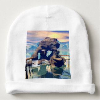 Fantasy landscape with a rock in the ocean baby beanie