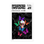 Fantasy skull and colored butterflies postage stamps