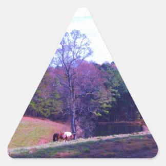 Far Away Horse in a Purple Field Triangle Sticker