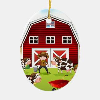 Farmer and barn ceramic ornament