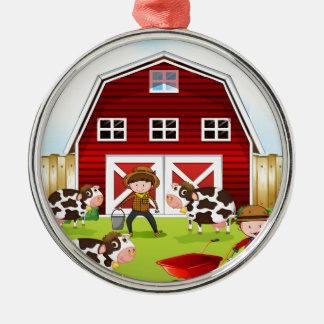 Farmer and barn metal ornament