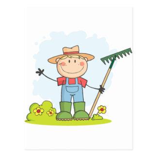 Farmer boy with a rake in grass postcard