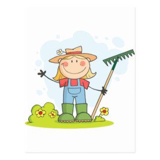 Farmer girl with a rake in grass postcard