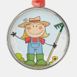 Farmer girl with a rake in grass round metal christmas ornament