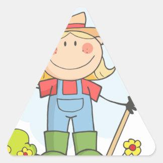 Farmer girl with a rake in grass sticker