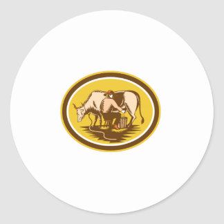 Farmer Milking Cow Oval Woodcut Classic Round Sticker
