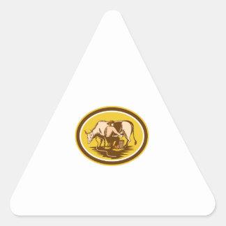Farmer Milking Cow Oval Woodcut Triangle Sticker