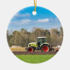 Farmer on tractor plowing sandy soil in spring ceramic ornament