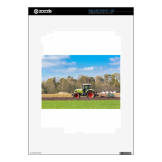 Farmer on tractor plowing sandy soil in spring iPad 2 decals