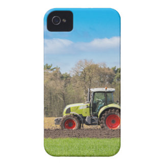 Farmer on tractor plowing sandy soil in spring iPhone 4 case