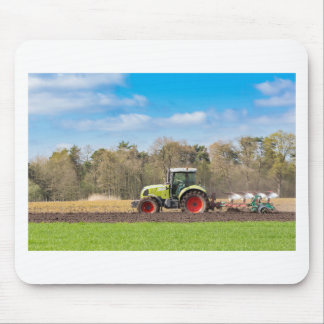 Farmer on tractor plowing sandy soil in spring mouse pad