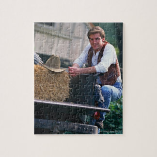 Farmer posing by pickup truck with hay bale jigsaw puzzle