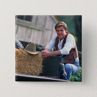 Farmer posing by pickup truck with hay bale pinback button
