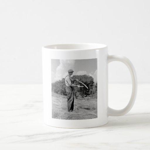 Farmer Sharpening a Scythe, 1930s Coffee Mug