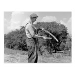 Farmer Sharpening a Scythe, 1930s Postcard