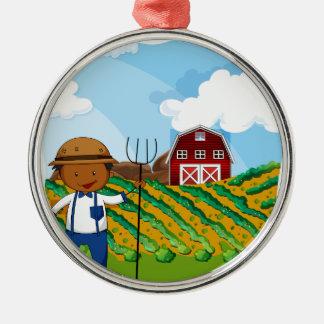 Farmer working in the farmland metal ornament