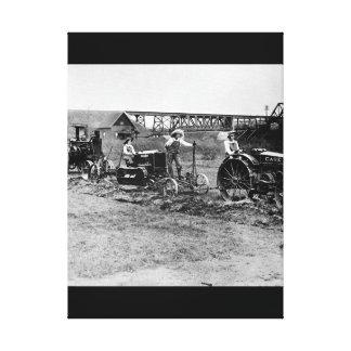 Farmerettes guiding tractors._War image Canvas Print