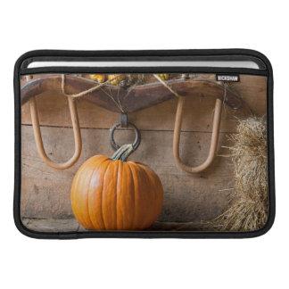 Farmers Museum. Pumpkin in barn with bale of hay MacBook Air Sleeve