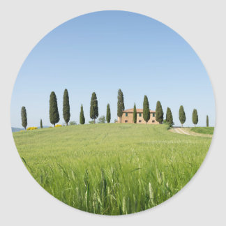 Farmhouse in Tuscany with cypresses round sticker